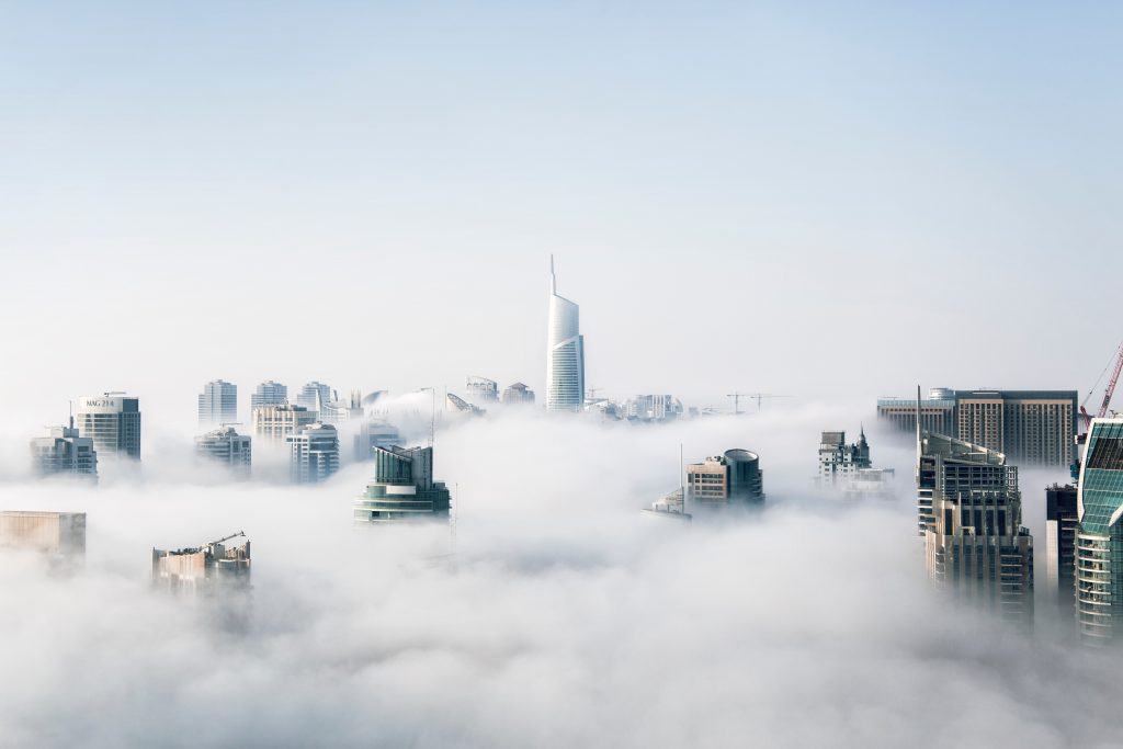 Giant buildings crossing the clouds